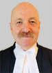 Bruce Thompson, MA LLB, wearing barristers robes - 40 years experience as a litigator including work with complex real estate and strata litigation - for clients in the Metro Vancouver region from his Richmond, BC offices