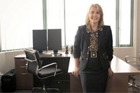 Anna Perry, family lawyer / mediator by her desk in West Broadway Office - click to web site